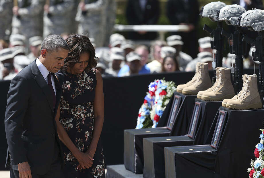 President Barack Obama and first lady Michelle Obama pay their respects at a memorial to the three soldiers slain during a shooting rampage April 2 at Fort Hood. The gunman, Spc. Ivan Lopez, also killed himself. Photo: Photos By Jerry Lara / San Antonio Express-News / ©2014 San Antonio Express-News
