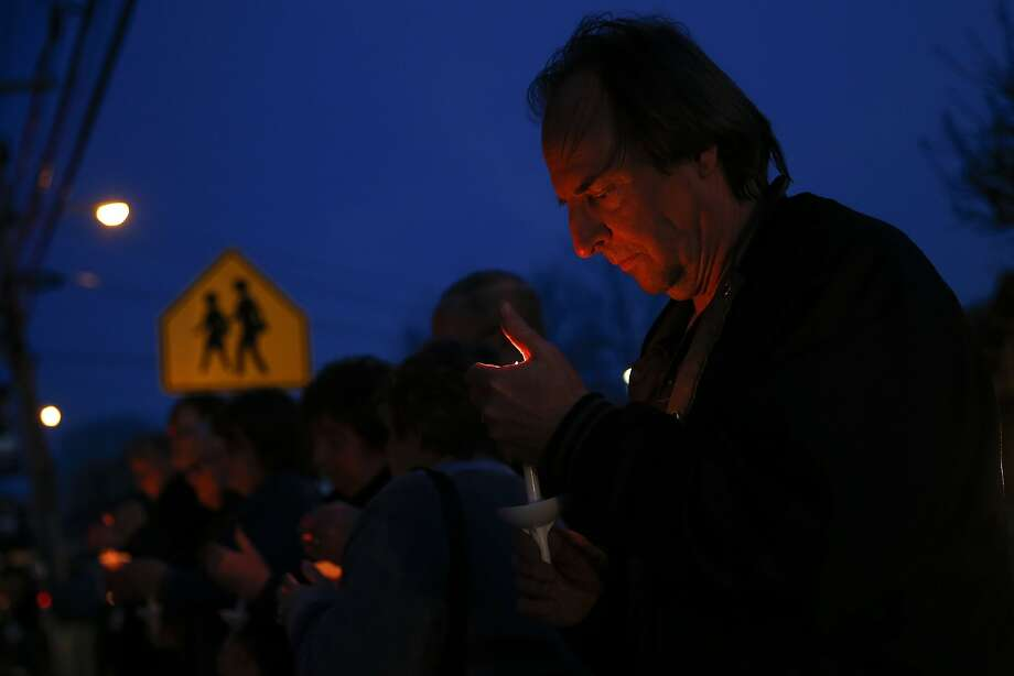 A man holds a candle during a prayer vigil for victims of the Franklin Regional High School stabbing rampage, at Calvary Lutheran Church in Murrysville, Pennsylvania April 9, 2014. A 16-year-old student wielding two knives went on a stabbing rampage in the hallways of the Pittsburgh-area high school on Wednesday, wounding 22 people before he was tackled by an assistant principal, officials said.   REUTERS/Shannon Stapleton  (UNITED STATES - Tags: CRIME LAW RELIGION) Photo: Shannon Stapleton, Reuters