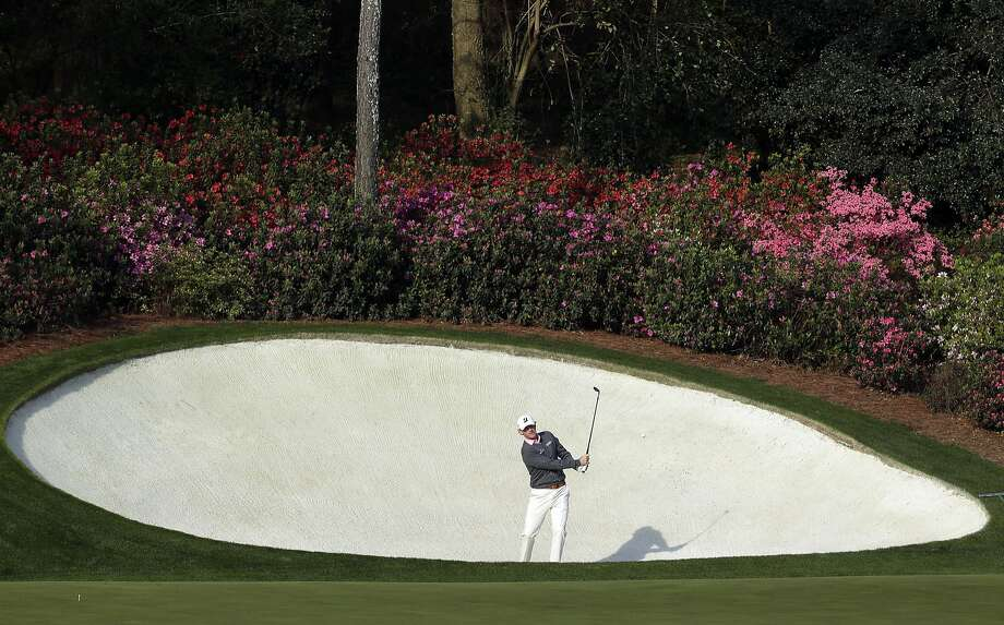 Brandt Snedeker hits out of a bunker on the 13th hole during a practice round for the Masters golf tournament Wednesday, April 9, 2014, in Augusta, Ga. (AP Photo/Chris Carlson) Photo: Chris Carlson, Associated Press