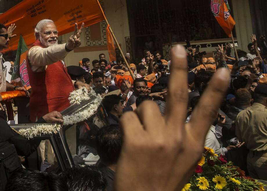 VADODRA, INDIA - APRIL 09: Bharatiya Janata Party (BJP) leader Narendra Modi gestures to supporters as he rides in an open jeep on his way to file nomination papers on April 9, 2014 in Vadodra, India.  India is in the midst of a nine-phase election from April 7-May 12.  (Photo by Kevin Frayer/Getty Images) *** BESTPIX *** Photo: Kevin Frayer, Getty Images