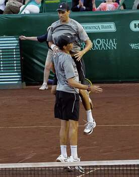 Mike Bryan and Bob Bryan defeated the team of Matthew Ebden and Samuel Groth Wednesday, April 9, 2014 at the River Oaks Country Club. (Bob Levey/Special To The Chronicle) Photo: Bob Levey, Houston Chronicle / ©2014 Bob Levey