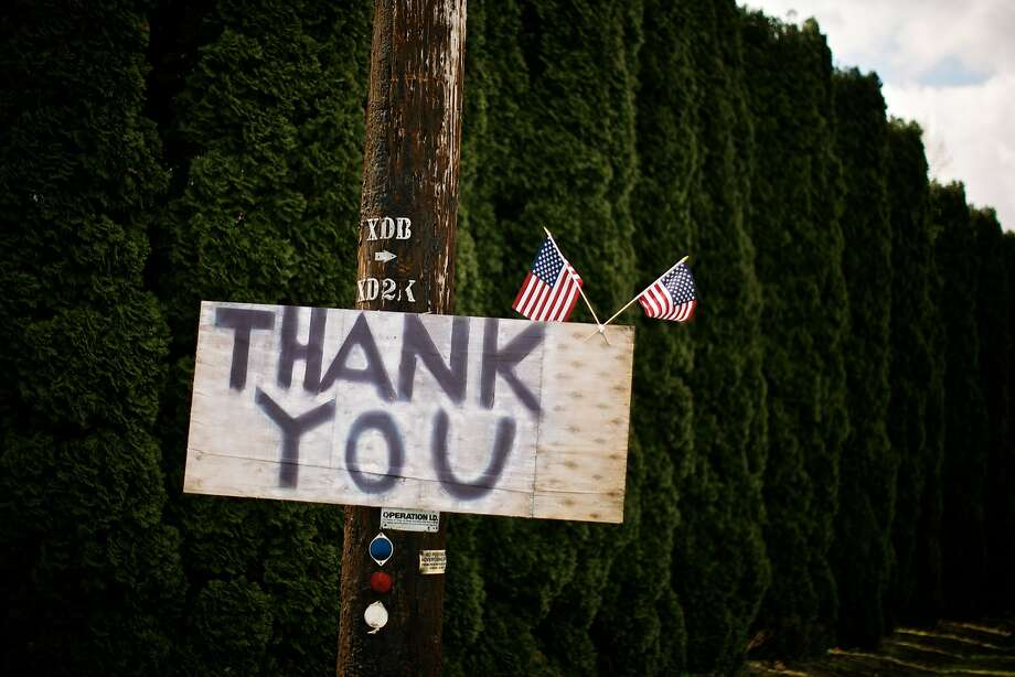 Townspeople have erected all manner of signs to show their appreciation for search and rescue personnel working on the landslide in Oso, Wash., Wednesday, April 9, 2014. (AP Photo/The Oregonian, Thomas Boyd) Photo: Thomas Boyd, Associated Press