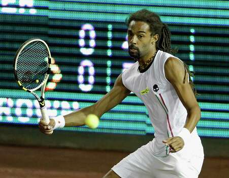 Dustin Brown hits a return against John Isner Wednesday, April 9, 2014 at the River Oaks Country Club. (Bob Levey/Special To The Chronicle) Photo: Bob Levey, Houston Chronicle / ©2014 Bob Levey