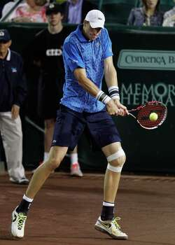John Isner hits a return against Dustin Brown during a tennis match Wednesday, April 9, 2014 at the River Oaks Country Club. (Bob Levey/Special To The Chronicle) Photo: Bob Levey, Houston Chronicle / ©2014 Bob Levey