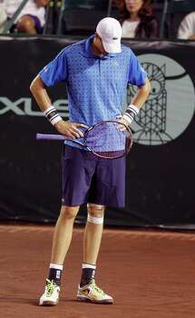 John Isner reacts after missing  a shot during a tennis match against  Dustin Brown Wednesday, April 9, 2014 at the River Oaks Country Club. (Bob Levey/Special To The Chronicle) Photo: Bob Levey, Houston Chronicle / ©2014 Bob Levey