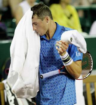 John Isner wipes his face between games Wednesday, April 9, 2014 at the River Oaks Country Club. (Bob Levey/Special To The Chronicle) Photo: Bob Levey, Houston Chronicle / ©2014 Bob Levey