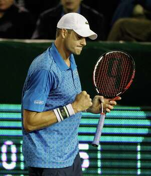 John Isner pumps his fist after winning a point against Dustin Brown Wednesday, April 9, 2014 at the River Oaks Country Club. (Bob Levey/Special To The Chronicle) Photo: Bob Levey, Houston Chronicle / ©2014 Bob Levey