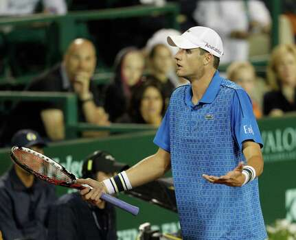 John Isner questions the umpire during a match against Dustin Brown Wednesday, April 9, 2014 at the River Oaks Country Club. (Bob Levey/Special To The Chronicle) Photo: Bob Levey, Houston Chronicle / ©2014 Bob Levey
