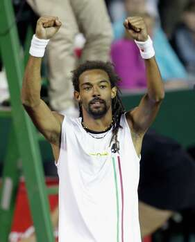 Dustin Brown celebrates after defeating  John Isner Wednesday, April 9, 2014 at the River Oaks Country Club. (Bob Levey/Special To The Chronicle) Photo: Bob Levey, Houston Chronicle / ©2014 Bob Levey