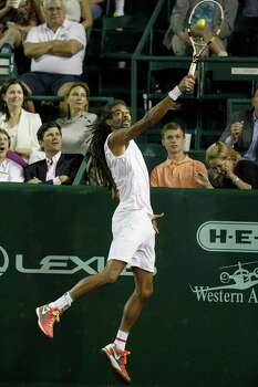Dustin Brown hits a return against John Isner at the U.S. Men's Clay Court Championship tennis tournament on Wednesday, April 9, 2014, in Houston. (AP Photo/Houston Chronicle, Bob Levey) MANDATORY CREDIT Photo: Bob Levey, Associated Press / Houston Chronicle