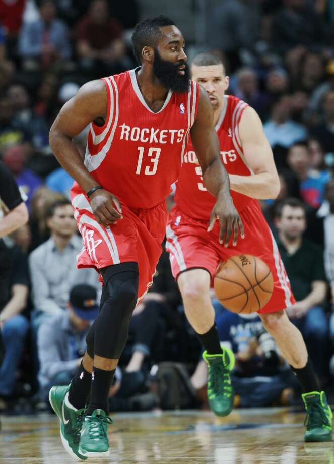 April 9: Nuggets 123, Rockets 116  Rockets guard James Harden, front, picks up a loose ball as guard Francisco Garcia, of the Dominican Republic, follows. Photo: David Zalubowski, Associated Press