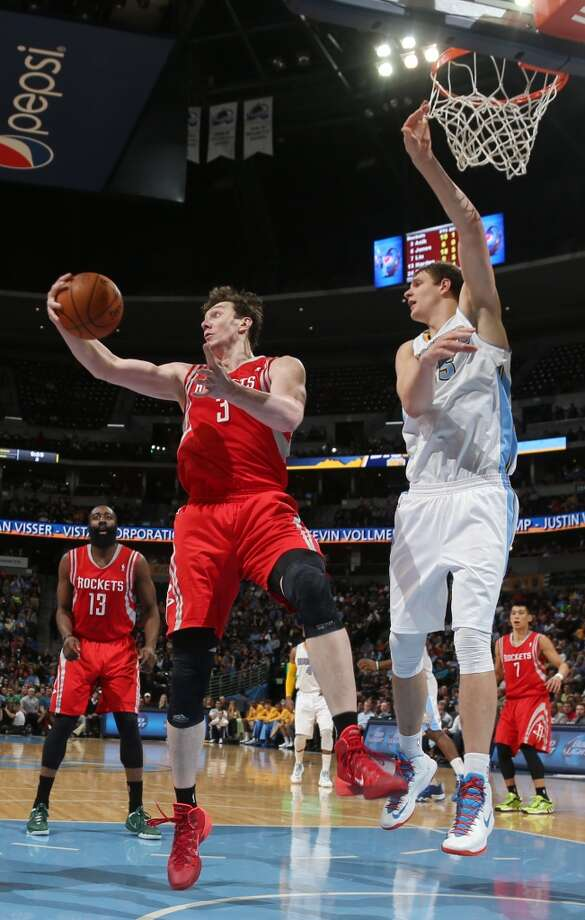 Rockets center Omer Asik, left, of Turkey, pulls in the rebound as Nuggets center Timofey Mozgov, of Russia, covers. Photo: David Zalubowski, Associated Press