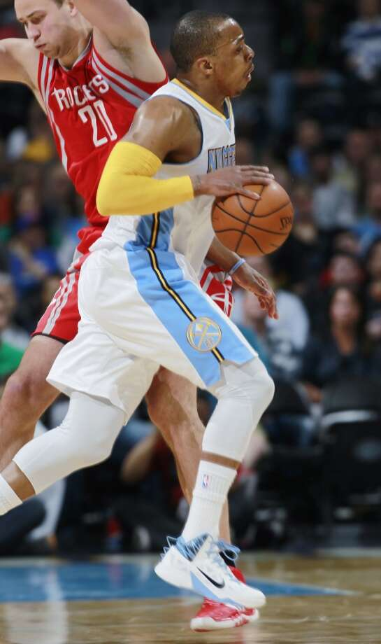 Nuggets guard Randy Foye, front, runs into Rockets forward Donatas Motiejunas, of Lithuania. Photo: David Zalubowski, Associated Press
