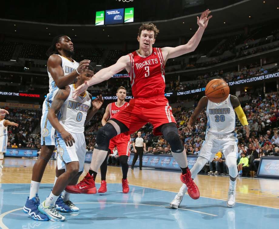 Rockets center Omer Asik, third from left, of Turkey, loses control of the ball under the basket as, from left, Nuggets forward Kenneth Faried, guard Aaron Brooks and forward Quincy Miller cover. Photo: David Zalubowski, Associated Press