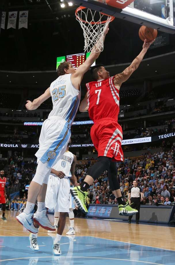 Rockets guard Jeremy Lin, right, goes up for a shot as Nuggets center Timofey Mozgov, of Russia, covers. Photo: David Zalubowski, Associated Press