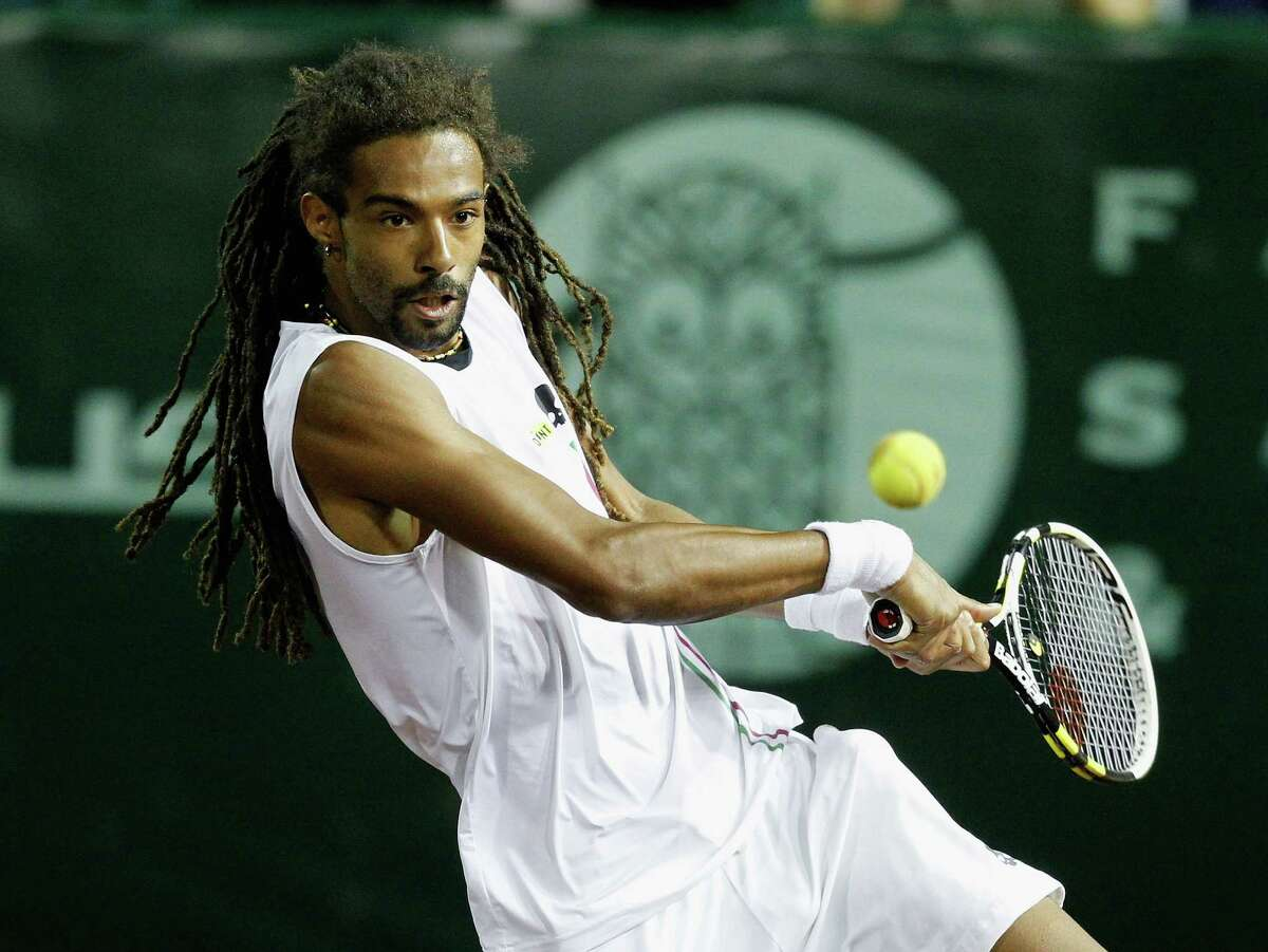 Dustin Brown, left, pulled off enough shots Wednesday to frustrate John Isner and send the defending Clay Court champion packing.