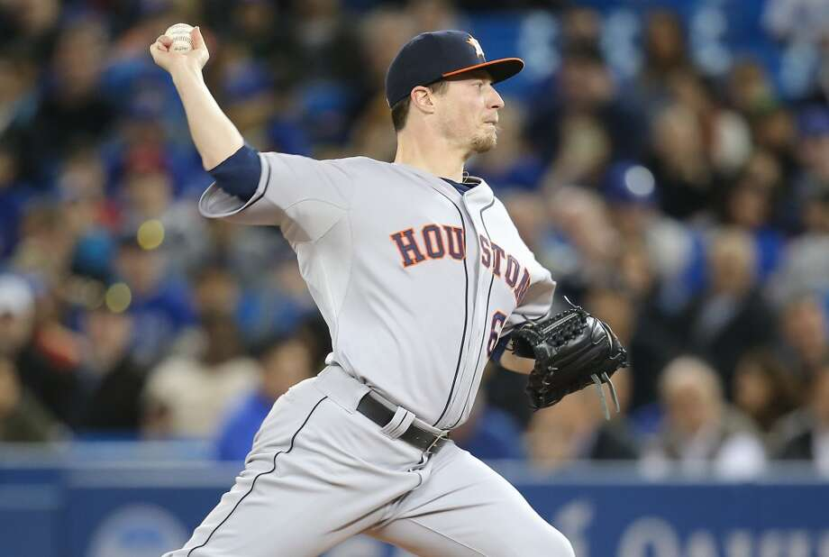 April 9: Blue Jays 7, Astros 3  Lucas Harrell of the Astros delivers a pitch. Photo: Tom Szczerbowski, Getty Images