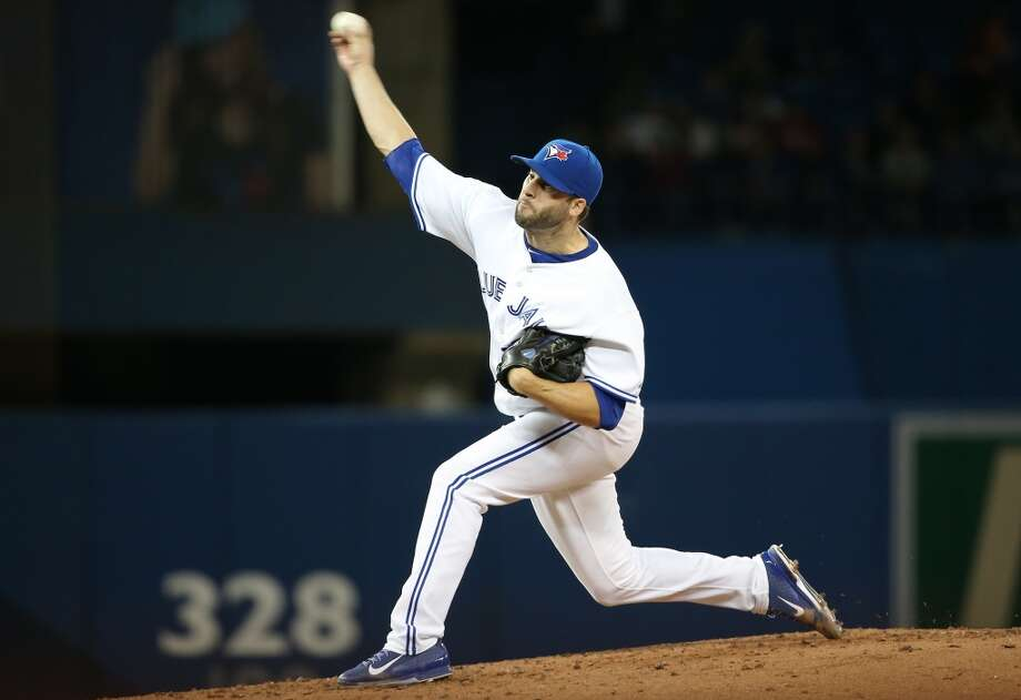 Brandon Morrow of the Blue Jays delivers a pitch. Photo: Tom Szczerbowski, Getty Images