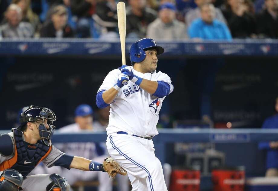 Dioner Navarro of the Blue Jays hits a double. Photo: Tom Szczerbowski, Getty Images