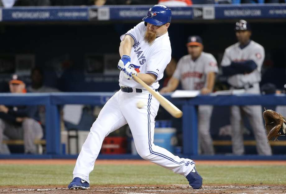Adam Lind of the Blue Jays hits an RBI single. Photo: Tom Szczerbowski, Getty Images