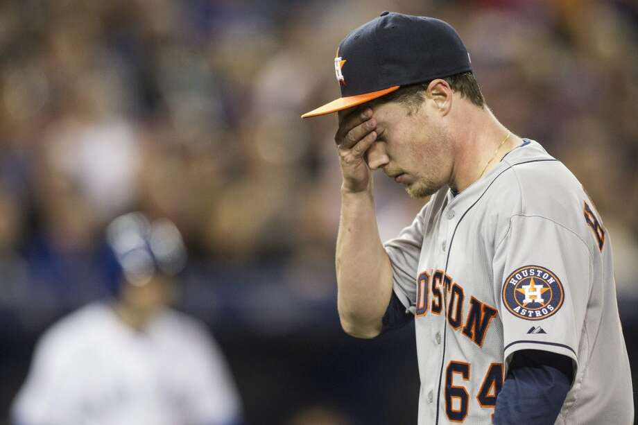 Astros starting pitcher Lucas Harrell returns to the dugout. Photo: Chris Young, Associated Press