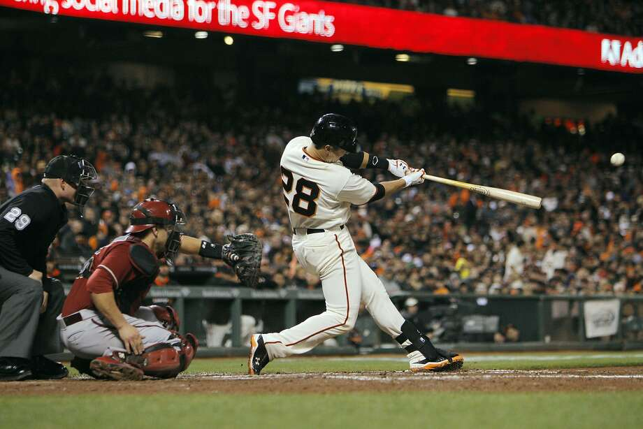 Buster Posey (28) hits a solo homerun in the fifth inning. The San Francisco Giants played the Arizona Diamondbacks at AT&T Park in San Francisco, Calif., on Wednesday, April 9, 2014. Photo: Carlos Avila Gonzalez, The Chronicle