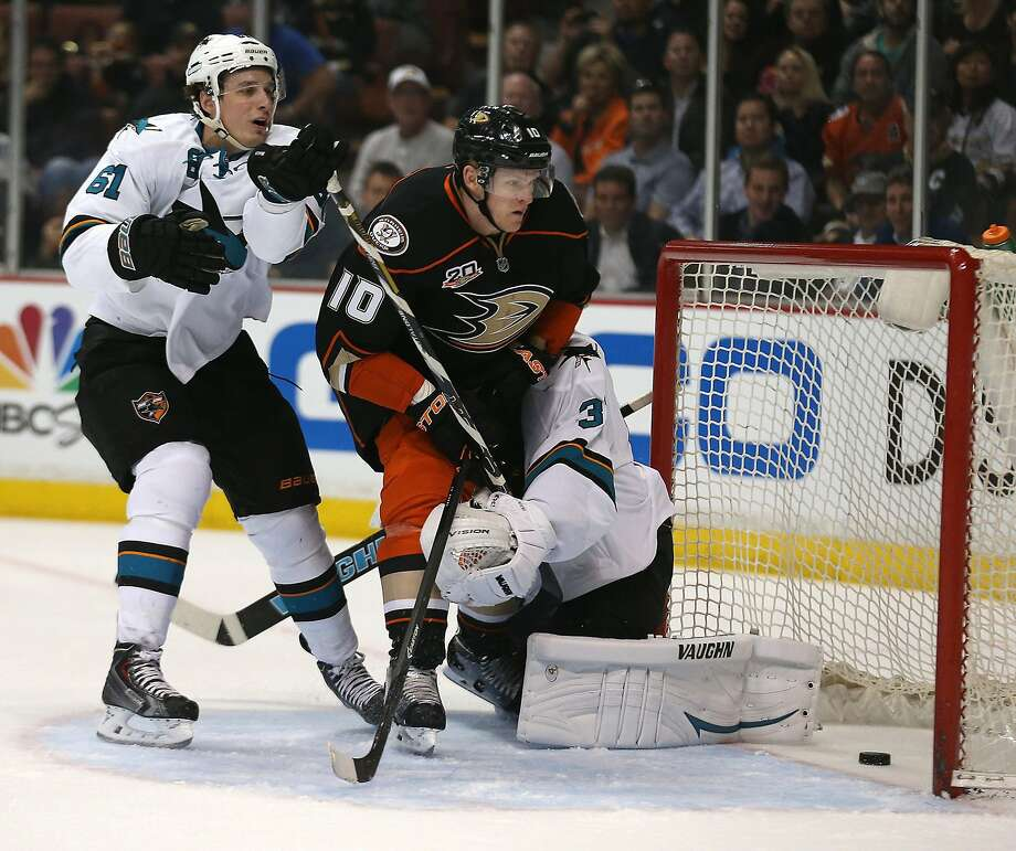 The Anaheim Ducks' Corey Perry (10) watches his shot go into the net against San Jose Sharks goalie Antti Niemi, right, and defenseman Justin Braun at the Honda Center in Anaheim on Wednesday, April 9, 2014. (Brian van der Brug/Los Angeles Times/MCT) Photo: Brian Van Der Brug/Los Angeles Times/MCT