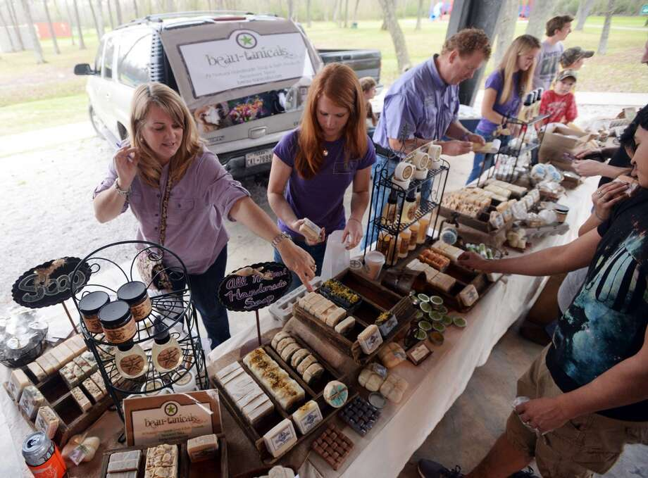 Shari and Kaitlyn Cribbs, from left, work the Beau-tanicals booth during Saturday's market. The Beaumont Farmer's Market opened for business at the Beaumont Athletic Complex on Saturday morning. Photo taken Saturday, 3/15/14 Jake Daniels/@JakeD_in_SETX