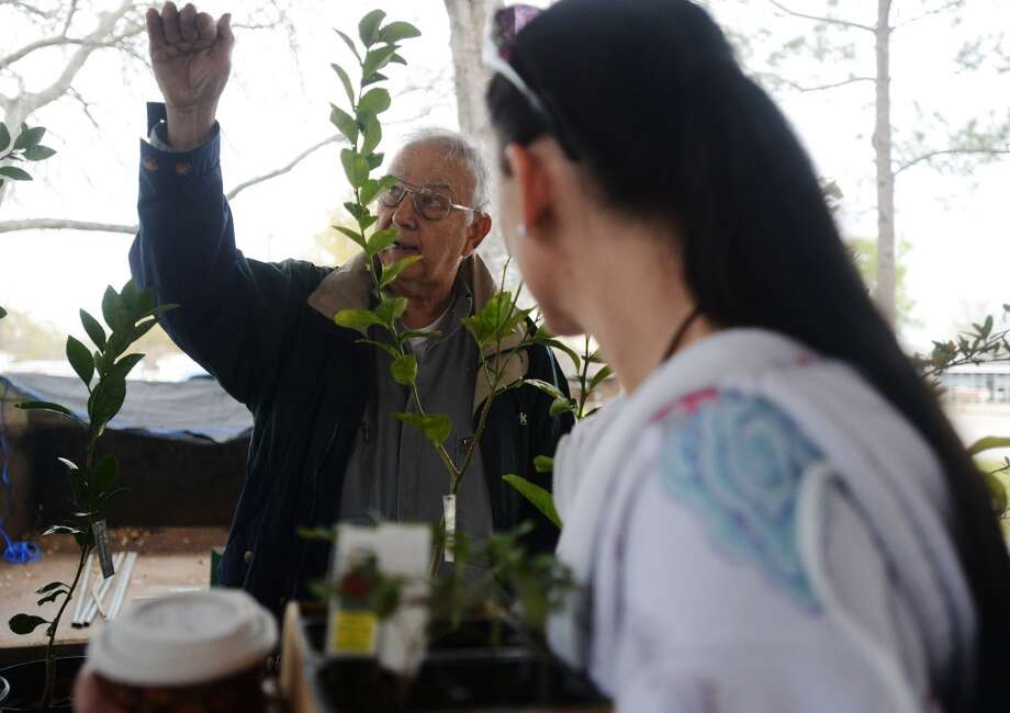 Eddie Wharton, back, describes a plant's growth to Jennifer Willis during Saturday's market. The Beaumont Farmer's Market opened for business at the Beaumont Athletic Complex on Saturday morning. Photo taken Saturday, 3/15/14 Jake Daniels/@JakeD_in_SETX