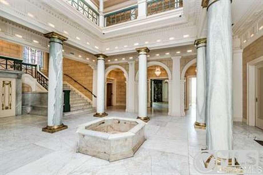 The atrium's indoor fountain Photo: MLS