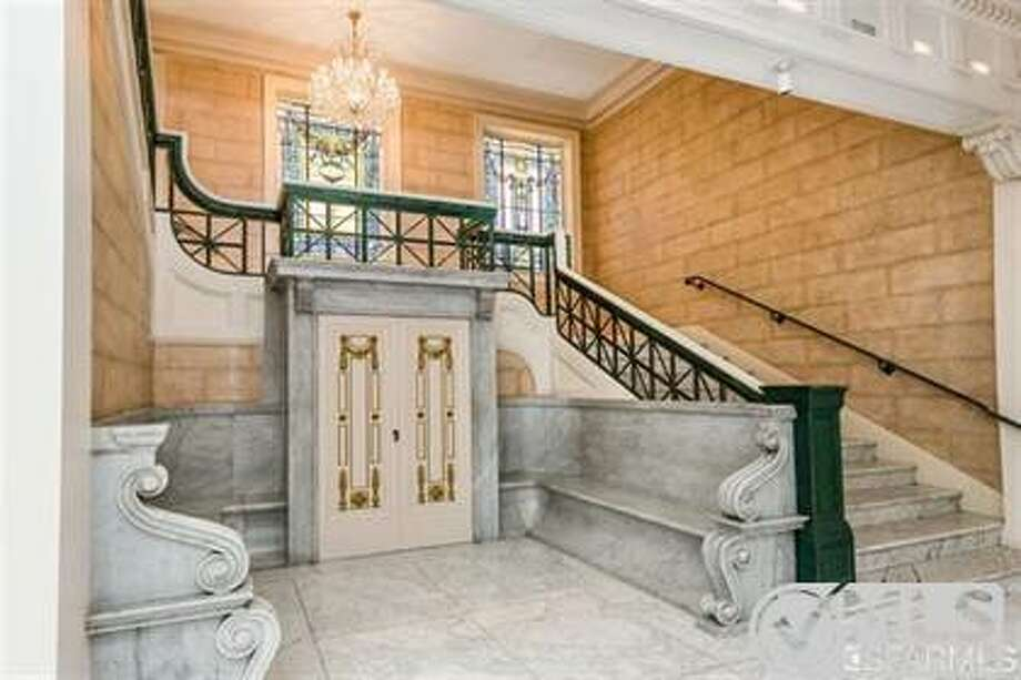 Marble benches at the base of the staircase Photo: MLS