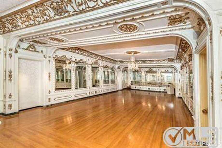The ballroom maintains many of its original decorative features. Photo: MLS