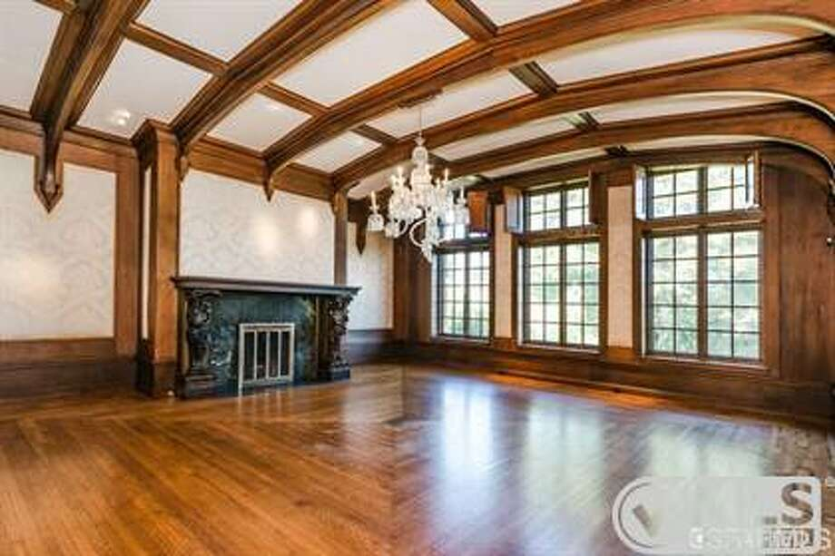A wood-burning fireplace in a dining room Photo: MLS