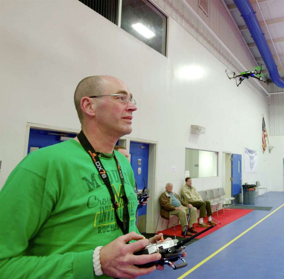Hobbyist Chris Kendra, 52, of Pawing, New York, hovers a Nano QX Quad Copter right in front of his face, at the Police Activities League on Hayestown Road, in Danbury, Conn., on Wednesday night, April 9, 2014. Photo: H John Voorhees III / The News-Times Freelance