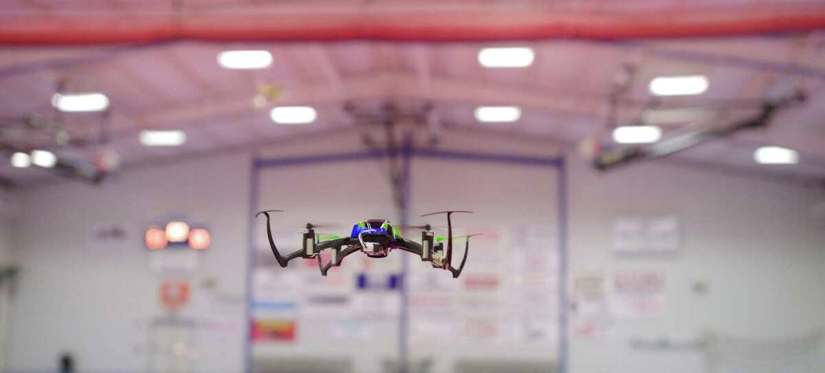 Hobbyist Chris Kendra, 52, of Pawing, New York, flies a Nano QX Quad Copter at the Police Activities League on Hayestown Road, in Danbury, Conn., on Wednesday night, April 9, 2014.