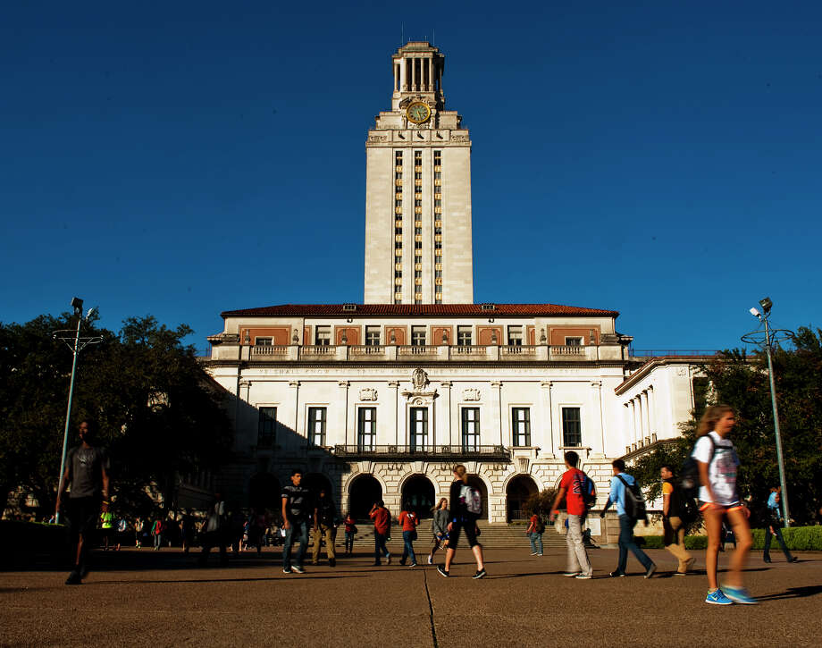 University of Texas students and faculty make thier way through campus via the UT Tower on Tues., Nov. 19, 2013 in Austin.  Click through to see changes to college tuition around Texas.  Contributed by Ashley Landis Photo: Ashley Landis, Wire / copyright 2013 Ashley Landis