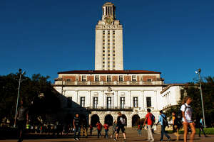 University of Texas students and faculty make thier way through campus via the UT Tower on Tues., Nov. 19, 2013 in Austin.  The UT Chapter of the Young Conservatives of Texas planned to host a �Catch an Illegal Immigrant Game� on campus later this week.  The game, which involved rewarding students with $25 gift cards if they �catch� volunteers posing on campus as an undocumented immigrants, was cancelled due to fear of retaliation from university officials.  Contributed by Ashley Landis