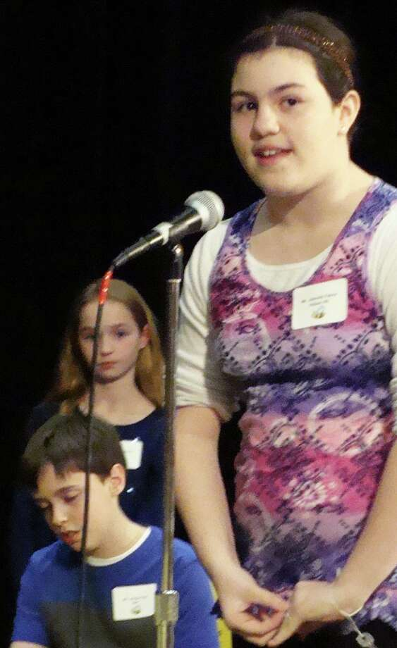 "Gabriella Fabrizi, 10, a fifth-grader at Holland Hill Schoo, won the 32nd annual Fairfield Spelling Bee by correcly spelling ""insecticide."" Photo: Meg Barone / Fairfield Citizen"