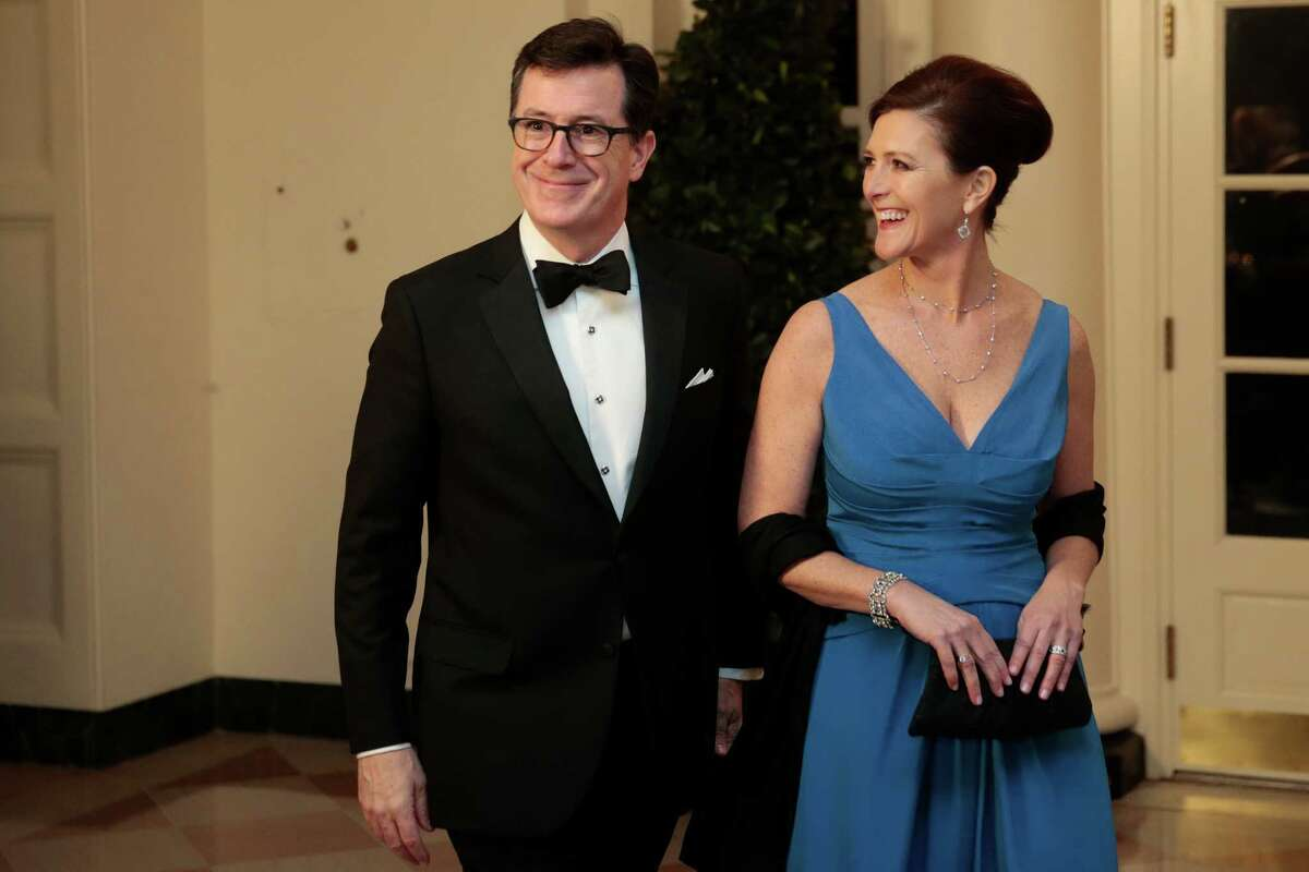Actor and television host Stephen Colbert, left, and Evie Colbert arrive to a state dinner hosted by U.S. President Barack Obama and U.S. first lady Michelle Obama in honor of French President Francois Hollande at the White House on February 11, 2014.