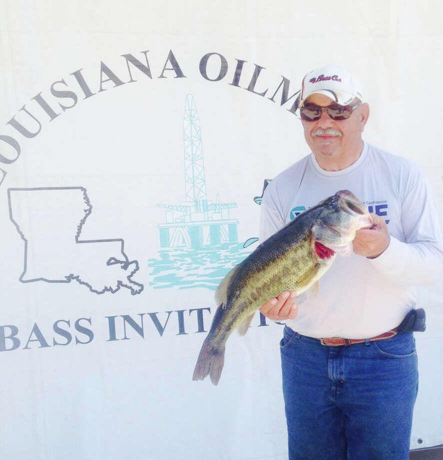 Tony Cosenza is shown with his Big Bass of the 2014 LOBI tournament, a 8.89 pound lunker. Photo by Derek Mong