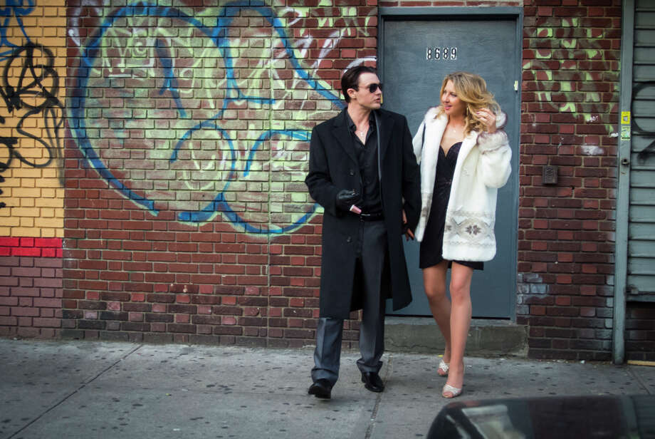 Michael Pitt as  Tommy  and Nina Arianda as  Rosie  in ROB THE MOB.