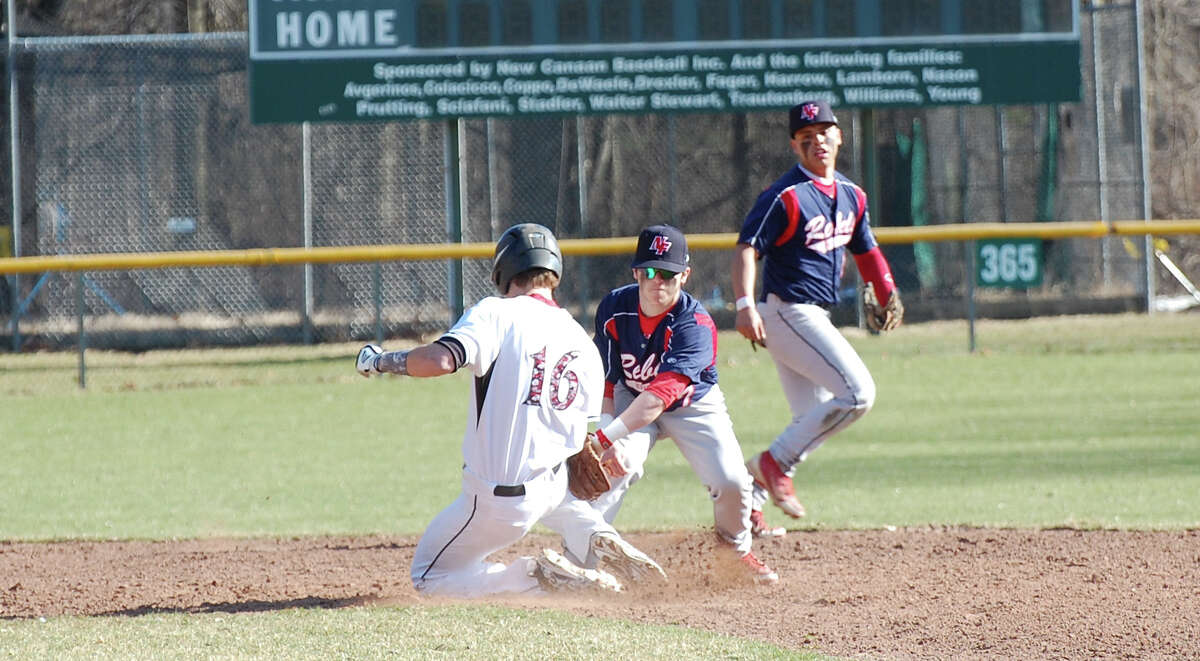 New Canaan's Erik Jager (16) gets to second base under the tag against New Fairfield in the Rams' season opener at Mead Park in New Canaan on Wednesday, April 9.