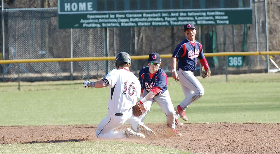 New Canaan's Erik Jager (16) gets to second base under the tag against New Fairfield in the Rams' season opener at Mead Park in New Canaan on Wednesday, April 9. Photo: Dave Crandall / New Canaan News freelance