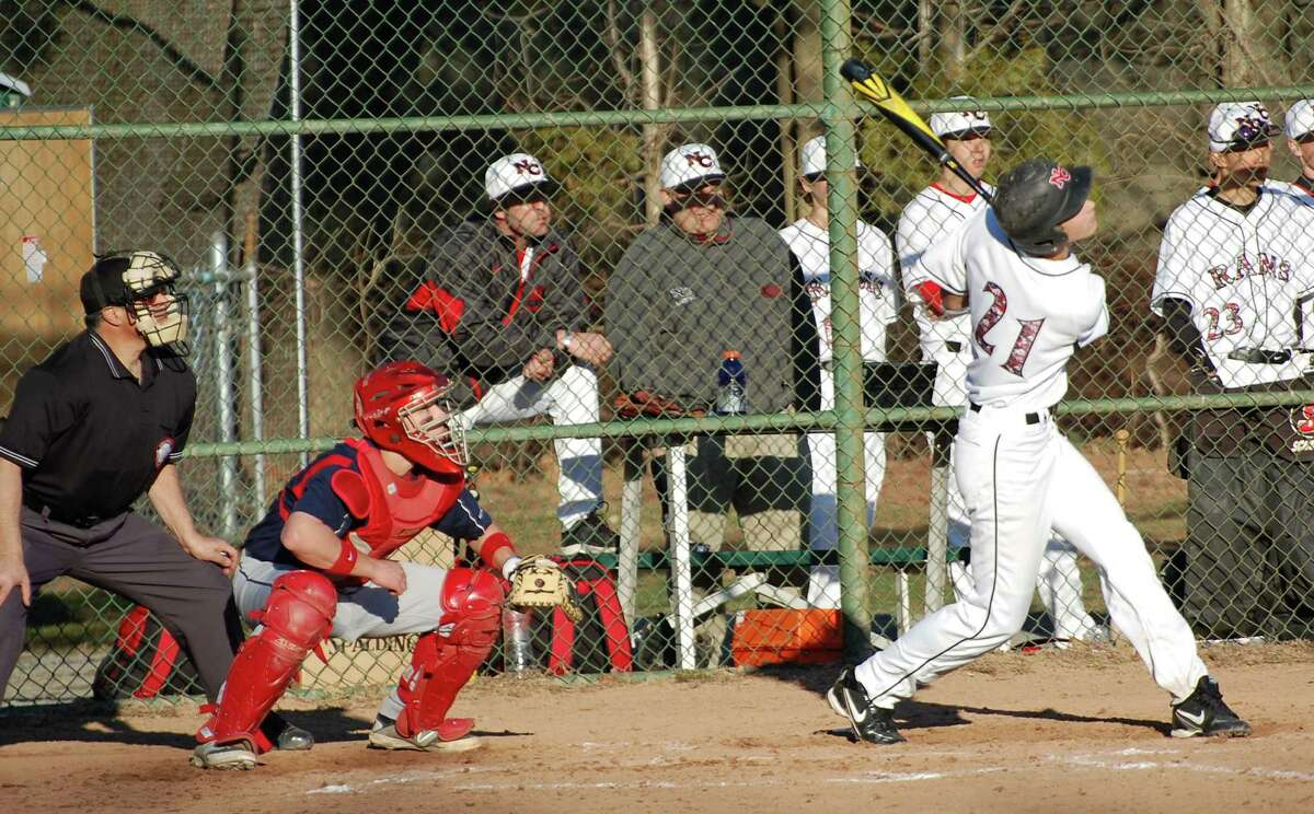 New Canaan's Kane Curtin lifts a ball to left field agaisnt New Fairfield in the Rams' season opener at Mead Park in New Canaan on Wednesday, April 9.