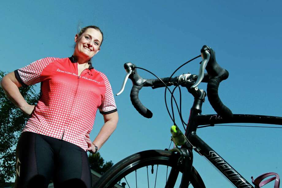Tammy Miller poses with her bike Tuesday, April 8, 2014. She was diagnosed with MS in 2010 and is riding the MS 150 for the first time with a team from Norton Rose Fulbright, the law firm where she works. ( Melissa Phillip / Houston Chronicle ) Photo: Melissa Phillip, Staff / © 2014  Houston Chronicle