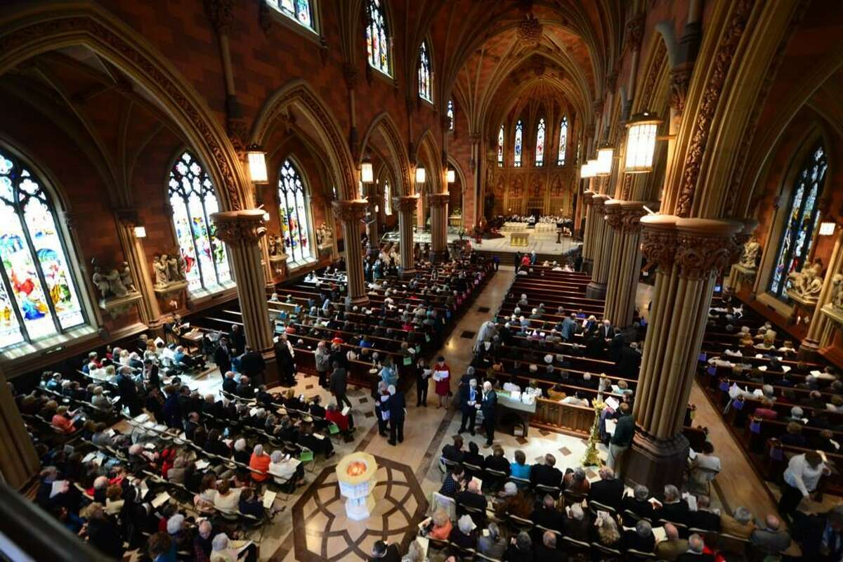 Guests fill the pews at the Cathedral of the Immaculate Conception for the installation and ordination of Bishop Edward Scharfenberger on Thursday, April 10, 2014. (Will Waldron / Times Union)