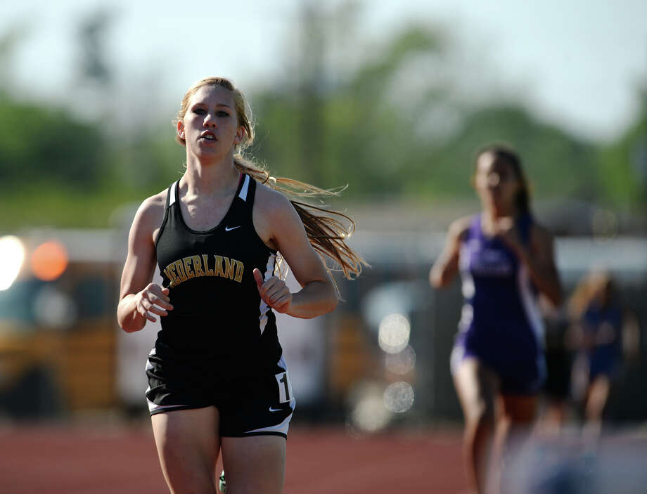 Nederland's Kinsey Miller competes in the 800 meter run Wednesday. The District 20-4A Varsity Track Meet finals were held Wednesday afternoon at Babe Zaharias Stadium.