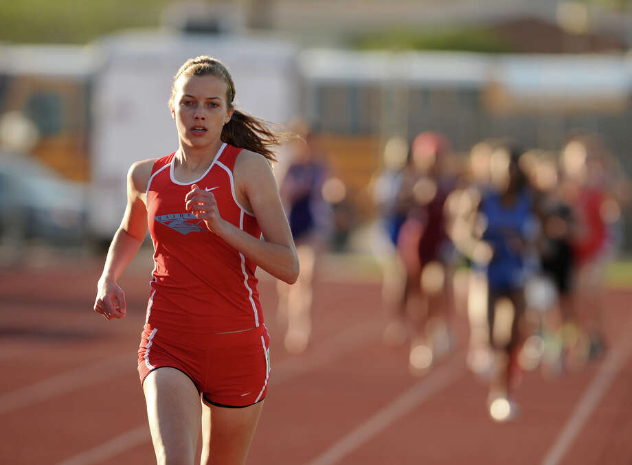 Lumberton's Jordan Welborn competes in the 1600 meter run during Wednesday's track finals. The District 20-4A Varsity Track Meet finals were held Wednesday afternoon at Babe Zaharias Stadium. Photo taken Wednesday, 4/9/14 Jake Daniels/@JakeD_in_SETX Photo: Jake Daniels / ©2014 The Beaumont Enterprise/Jake Daniels