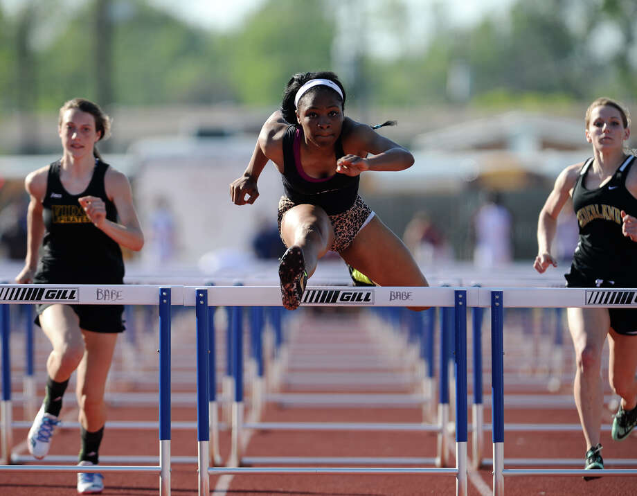 Central's Paizley Armstrong competes in the 100 meter hurdles during Wednesday's track finals. The District 20-4A Varsity Track Meet finals were held Wednesday afternoon at Babe Zaharias Stadium.