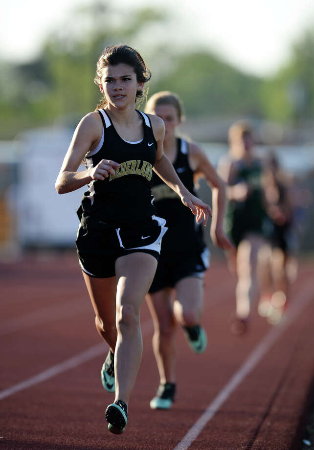 Nederland's Madison Ledet competes in the 1600 meter run during Wednesday's track finals. The District 20-4A Varsity Track Meet finals were held Wednesday afternoon at Babe Zaharias Stadium.